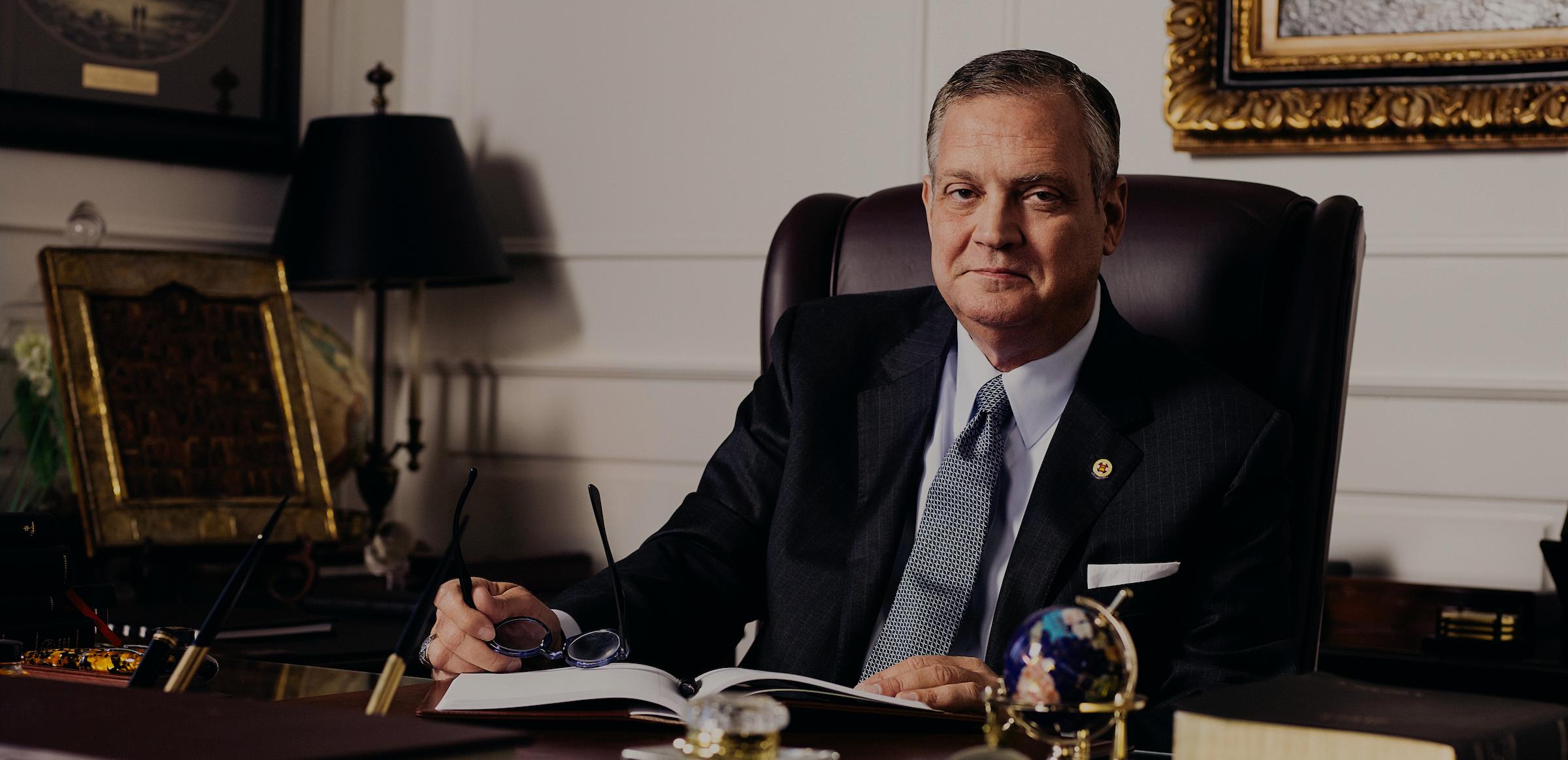 Dr. R. Albert Mohler Jr. sitting at Presidential desk