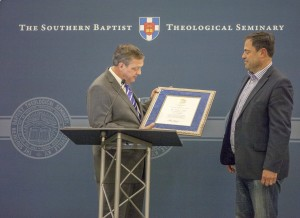 Southern Seminary President R. Albert Mohler Jr. (left) presents Mark Dever, senior pastor of Capitol Hill Baptist Church in Washington, D.C., with the 2014 Distinguished Alumnus of the Year Award.