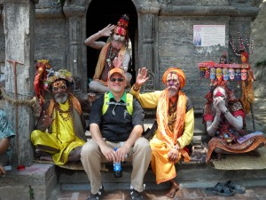 Dennis McDaniel, a recent M.Div. graudate from Southern Seminary, sits with four Hindu holy men on the steps of a temple in South Asia.