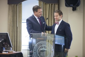 R. Albert Mohler Jr., president of The Southern Baptist Theological Seminary, welcomes Daniel Patz, president of Northland International University, during the Oct. 14 meeting of the seminary's Board of Trustees after the body voted to accept the gift of Northland's campus in Dunbar, Wisconsin.