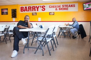 Barry Washington, 51, is the owner of Barry's Cheese Steaks and pastor of Redeemed Christian Church in Louisville's West End.