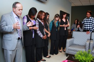 Núñez prays with the IBI worship team before the morning worship service, Jan. 11.