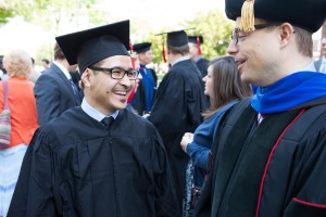 Boyce graduate Timur Nesbitt (left) stands with professor Barry Joslin (right) at the May 8 commencement ceremony.