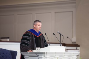 Boyce Dean Dan DeWitt delivers a charge to graduates at the May 8 commencement.