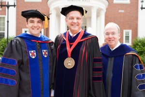 Ph.D. graduate Ben Dockery (left) stands with SBTS President R. Albert Mohler Jr. (center) and his father, Trinity International University President David S. Dockery (right), following the May 14 commencement exercises.