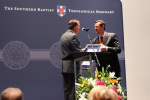 Southern Seminary President R. Albert Mohler Jr. presents KBC executive director Paul Chitwood with the Distinguished Alumnus of the Year award the June 17 SBC alumni luncheon.
