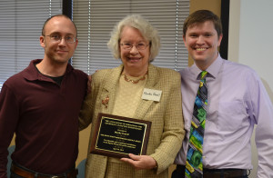 Martha Powell (center) receives...; pictured with Boyce Library archivists Adam Winters (right) and Chris Fenner (left).
