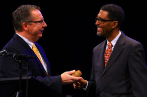 Tom James, left, hands off the president's gavel to Southern Seminary professor Kevin Smith, who was elected the first African-American president in Kentucky Baptist Convention history. Smith is teaching pastor at Highview Baptist Church in Louisville. (Photo by Robin Cornetet/Kentucky Today)