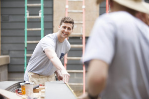 Tyler Clark, student life director at Southern Seminary, volunteers at Habitat for Humanity.