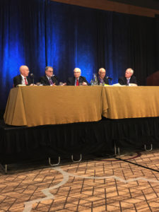 Theologians Wayne Grudem, Bruce A. Ware, Millard Erickson, Kevin Giles, and Sam Storms (left to right) participate in a discussion on authority and submission in the Trinity, Nov. 15 at the 68th annual meeting of the Evangelical Theological Society in San Antonio, Texas.