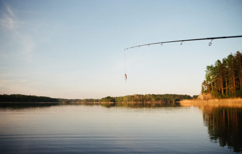 fishing pole over lake
